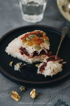 A modernized eight treasure rice that tastes so much better than the traditional version. Lightly sweetened sticky rice stuffed with red bean paste and topped with dried fruits and seeds, then served with a fragrant chrysanthemum syrup that has an amazing earthy aroma. The recipe uses ingredients that are easy to source and the cooking is quite simple. It's a light and healthy dessert that is perfect to serve at the end of a meal. {Vegan, Gluten-Free} Indian Food Recipes, Asian Recipes, Chinese Recipes, Ethnic Recipes, Asian Foods, Bakery Recipes, Cookbook Recipes, Potluck Recipes, Party Recipes