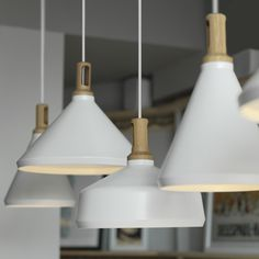 Nonla pendant lamps by Paul Crofts made from powder-coated spun aluminium, with CNC turned and routed American white oak tops.
