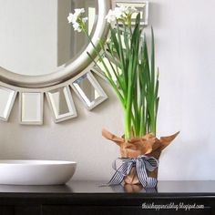 paperwhites for winter décor // brown wrapping paper with black & white ribbon