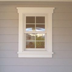 windowtrimideas exampleof a lap siding building with 2 x 4 wood - Exterior Window Moulding Designs