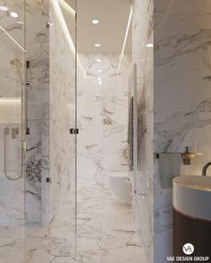 The floor to ceiling marble shower says glamour and luxury in this small studio apartment. The clear glass door makes the space feel bigger