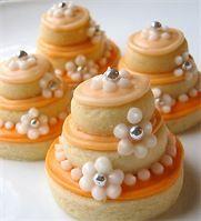 Stacked Wedding Cake Sugar Cookies In Tangerine Tango $31.00 per dozen, unwrapped $36.00 per dozen wrapped