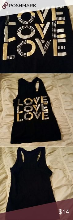 """Guess rank top Size extra small Guess brand """"LOVE"""" tank top. solid black with silver & gold lettering on front. Back is solid black. No jewels missing. Worn once, washed in cold and air dried. Like new, no flaws. If you have any questions please let me know. Offers are welcome. Guess Tops Tank Tops"""