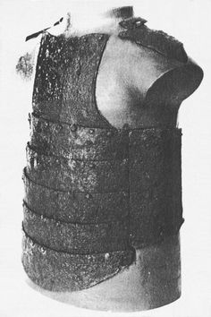 Coat od plates No. 1 from Korsbetningen. This is probably the most widely known of the 24 coat-of-plates from the mass graves of the Battle of Visby Sweden, (1361). The characteristic horizontal plates protecting the lower chest and stomach can be found on sculptures and illuminations contemporary with the event. However, only 7 of the coat-of-plates are of this type, the rest consisting of only vertical plates. (Antikvarisk-topografiska arkivet, Stockholm)
