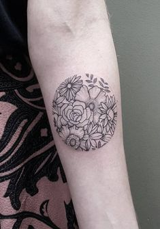 Blackwork circular flower tattoo