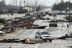 Debris scattered by Hurricane Ike covers State Highway 146 in Seabrook, Texas, on September 13, 2008.