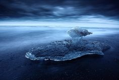 The Crystal Ship: A big strange Ice on the beach of Iceland.  Jokulsarlon beach in early july