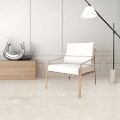 Galala marble effect large porcelain tiles with antibacterial properties used to create a warm and inviting floor in this modern lounge Large Floor Tiles, Tile Floor, Modern Lounge, Marble Effect, Porcelain Tiles, Wall Tiles, Dining Bench, Flooring, Warm