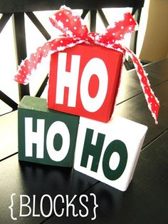 HO HO HO Blocks: All you need are some leftover 2x4's cut into 3 blocks, some HO HO HO vinyl, ribbon & paint. Paint your blocks red, green & white.  Let dry and then apply the vinyl lettering. Stack them up. Add some Christmas ribbon & that's it. Super cute!