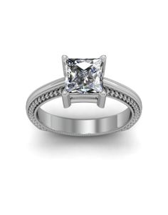 Inspired by vintage design, this diamond engagement ring in 14k white gold features milgrained edges that frame an engraved motif set with petite round diamonds to frame your center diamond. 3mm Single Claw Vintage Design.