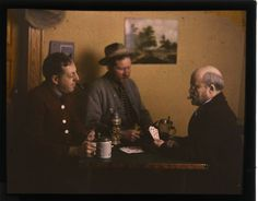 Three men playing cards, autochrome, c.1915