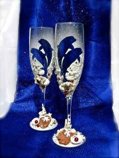 """Beautiful pair of two champagne flutes are hand painted with an original design. Decorated with real seashells, corals and sea stones. High 9"""". This glasses made for order, and they can't be made exactly the same again. Custom champagne glasses may be created to fit your needs. You can pick any shape of the clear part (dolphin is like an example). Any main color is available. Customizations are included in the price."""