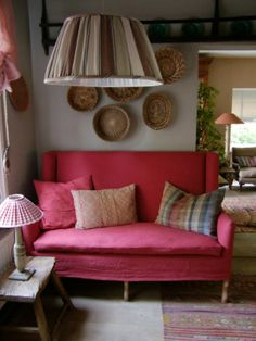 Definitely going to be on the lookout for a little loveseat like this for the basement hall by the fireplace.