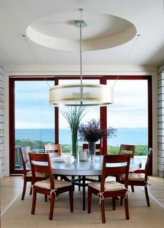 Beautiful - The open, airy dining room has a custom-designed dining table and light fixture.
