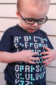 Braille alphabet t-shirt by Eye Power Kids Wear. Ink is raised so you can feel the braille!