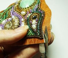 Step by step bead embroidery - great pictures. amazing the amount of work to complete these gorgeous beaded necklaces.
