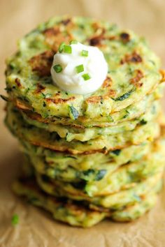 Zucchini Fritters by damndelicious: Easy to make, low calorie, and the perfect way to sneak in some veggies. #Fritters #Zucchini #Light