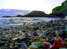 Glass Beach, California. Years ago, people used to dump their old trash (cars, bottles, cans, tires, etc....) on this beach and finally someone woke up and realized what a mess it was. Several major clean ups later, this beautiful cove covered in smoothed and polished glass is what's left behind.