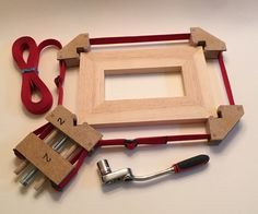 """A band clamp lets you clamp many different shapes for gluing that would be difficult to pull together with just standard bar or pipe clamps. Want to make a picture frame? Use a band clamp!You can easily and cheaply make your own band clamp to use on rectangular frames, furniture, circular objects, hexagons, octagons, n-gons …. and clamp anything of practical size!You will need a 4"""" by 10"""" hardwood board 3/4"""" thick, a 5"""" by 20"""" piece of 3/16"""" (tempered) ha..."""