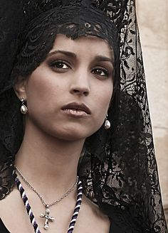 Spanish beauty with traditional Mantilla, Semana Santa, Andalucia, Spain.