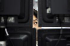 CLOSE MONITORING: A currency trader watched monitors in the foreign-exchange dealing room of the Korea Exchange Bank headquarters in Seoul Thursday. Asian stock markets plummeted Thursday after the U.S. Federal Reserve said it could start scaling back its stimulus program later this year. (Ahn Young-Joon/Associated Press)