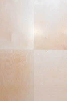 hand cut chequerboard plywood floor for a new design studio