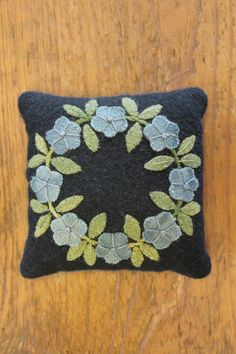 This item is a Handmade Pincushion that was made by Lisa Bongean herself. It is one of her signature pincushions that is filled with sand that