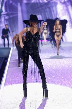 Lady Gaga performs on the runway with Swarovski crystals during Victoria's Secret Fashion Show on November 30, 2016 in Paris, France.