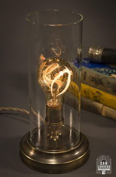 This Flickering Edison Bulb Table Lamp has an oscillating carbon filament that swings rapidly from side-to-side within the glass envelope. Edison Bulb Table Lamp, Edison Lamp, Edison Lighting, Light Bulb Lamp, Room Lamp, Desk Lamp, Bed Room, Paper Floor Lamp, Bobs