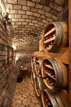 Rustic Wine Cellar with Wall sconce, Built-in bookshelf, Carpet, interior brick