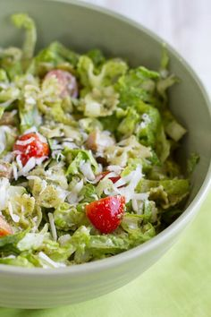 This recipe for Pesto Pasta and Ham Salad is the perfect mix of your favorite pasta salad and a crisp, fresh salad with romaine lettuce, grape tomatoes, grated Parmesan cheese, and walnut pesto!