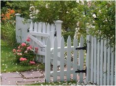 white picket fence for dog area