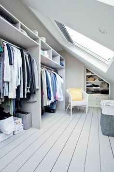 This bespoke dressing room (the stuff of dreams, right?) makes clever use of the space in the eaves with built in storage that combats the limitations of an awkward sloping roof. Bedroom ideas Loft conversion ideas and expert tips Attic Master Bedroom, Attic Bedroom Designs, Bedroom Wardrobe, Attic Rooms, Attic Spaces, Bedroom Loft, Modern Bedroom, Bedroom Ideas, Bedroom Decor