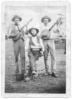 two banjos and what looks like a concertina