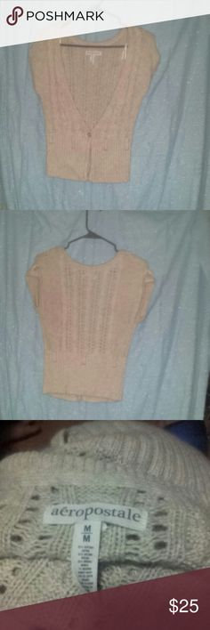 Aeropostale short sleeve cardigan This is in good condition. It has a couple puffy strings that need to be cut and ot will look brand new.  It has one bottom button and place for belt or scarf but that is not included.it is  like a cream beige color with gray speckles throughout. Aeropostale Sweaters Cardigans