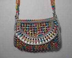 recycled aluminum pop tabs, hand crochet with blue, pink, orange and yellow variegated nylon yarn Poptabs Purse