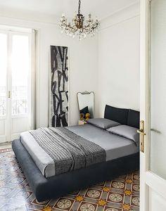 bedroom w/chandelier + french doors + tile flooring | Lorenzo Pennati photography
