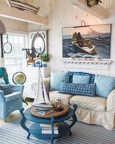 Model ships and other nautical accent pieces complement the ocean palette that Jinny McMillan has cultivated in her seaside New Harbor home. See more pictures of this cottage on our website. Photographed by @photocait. #Mainelife #cottage #ocean
