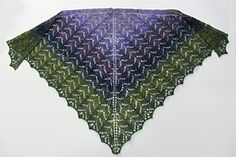 This is a triangular shawl that is knitted from the top down. It was designed to be flexible in terms of the kind and amount of yarn. My version of this shawl was knitted with about 370 yards of an 18 wpi handspun yarn. The finished shawl is 52 inches by 30 inches.