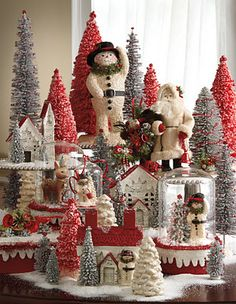 I love the old fashioned look of the glitter houses and snowman. Reminds me of my Great Aunt's house when I was a kid.