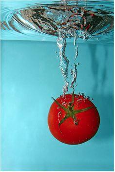 Lex Augusteijn: Tomato Splash. #photography, #colour, #fruit