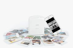 The Instax Printer - Bring your phone pics into the palm of your hand with this simple, wireless, take-anywhere printer ($220.00, http://photojojo.com/store)