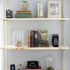 Show off your collection of accessories with hanging wood shelves.