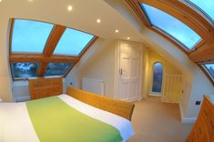 Even low roof loft conversions can be made to be airy with the use of a lot of veluxs 2 groups of 4 windows in one of our smaller loft conversions by apexloft.com this was a hip to gable loft. With en suite in the corner.