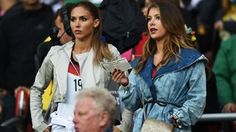 Ann-Kathrin Broemmel (L), girlfriend of Mario Goetze of Germany, and Montana Yorke, girlfriend of Andre Schuerrle of Germany