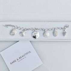 Our Coastal Charm bracelet has 7 different Tasmanian Sea Shells which are cast in solid...