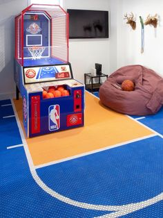 Decorating Ideas for Fun Playrooms and Kids' Bedrooms : If you're going to get an arcade game, why not get a floor to match? Not only are these rubber floor mats colorful and well thought out, they are ideal for a playroom because they are soft and warm o