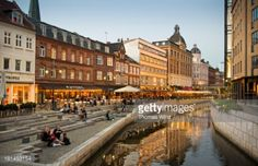 Restaurants and cafes along the Aarhus river at dusk. #arhus... #arhus: Restaurants and cafes along the Aarhus river at dusk.… #arhus