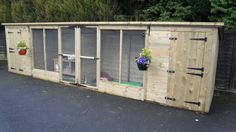 An open hutch within a nice long enclosure allows the rabbits to come and go as they please. I like the hanging flower baskets. Bunny Cages, Rabbit Cages, Animal Welfare Act, Rabbit Enclosure, Raising Rabbits, Hanging Flower Baskets, Rabbit Hutches, Types Of Houses, Play Houses