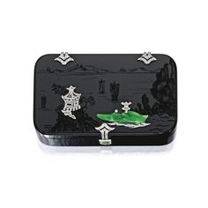 PLATINUM, ONYX, DIAMOND AND JADE BOX, FRANCE.  The carved onyx box depiciting a seascape, with a carved jade junk and a jade thumbpiece, decorated with a pagoda set with rose-cut diamonds, measuring approximately 3½ by 2 inches, stamped Made in France, with maker's marks for Societe des Alliages des Metaux; circa 1920. Estimate  6,000 — 8,000  USD  LOT SOLD. 20,000 USD